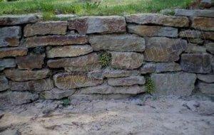 Как построить стену из камня
